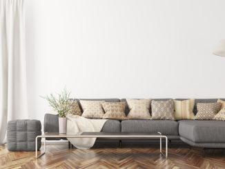 Moderner Innenraum des Wohnzimmers mit grauem Ecksofa, Wiedergabe des Couchtischs 3d